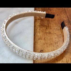 White satin-covered headband with plastic crystals